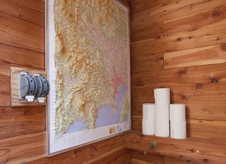 A Platform for Living - Photo 20 of 28 - A peek inside the bathroom, where a raised topographic map doubles as reading material and travel inspiration.