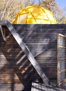 A Platform for Living - Photo 21 of 28 - The yellow North Face tent looms over the top of the main building.
