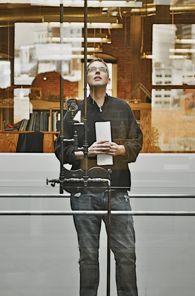 The author stops to check out the skylight. Photo by Thor Radford.