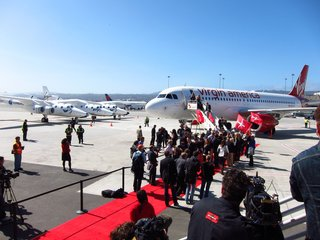 Virgin America is welcomed to its new home at SFO's Terminal 2 by Virgin Galactic's WhiteKnightTwo and a gaggle of press.