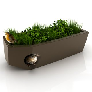 """Pousse Creative's design for a birdhouse with a """"green roof."""""""
