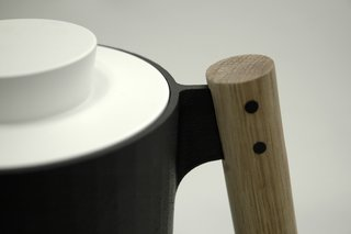 "The ""dowel handle,"" the trio writes, ""provides an ergonomic powergrip while contributing to the concept of cookware as 'tools.'"""