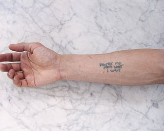 Tobias Wong, Protect Me From What I Want, 2002; artist tattoo; © Estate of Tobias Wong. Photo courtesy SFMOMA.