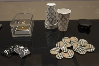 Another selection of objects on display including Unauthorized Burberry Buttons (1999). Burberry took to Wong's shenanigans and used the pins in one of their advertising campaigns. Photo courtesy SFMOMA.