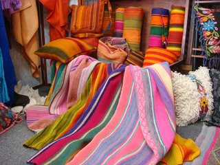 A trove of yet more vibrantly colored rugs, pillows, and blankets.