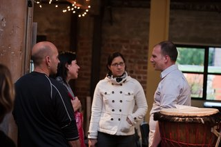 During pre-discussion drinks, Halbrecht chats with attendees in REBAR's studio space. Photo by Søren Schaumburg.