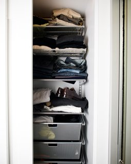 Elfa storage systems fit perfectly behind the sliding doors, and offered customizable options for keeping clothes organized.