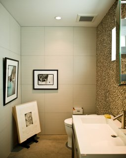 No room in the house is free from Jacobson's keen curatorial eye. The office bathroom is adorned with an original Glen E. Friedman image of skate legend Tony Alva (across from toilet) and a picture of Nathan Fletcher by Mark Oblow (adjacent). Framed on the floor is a George Condo illustration.