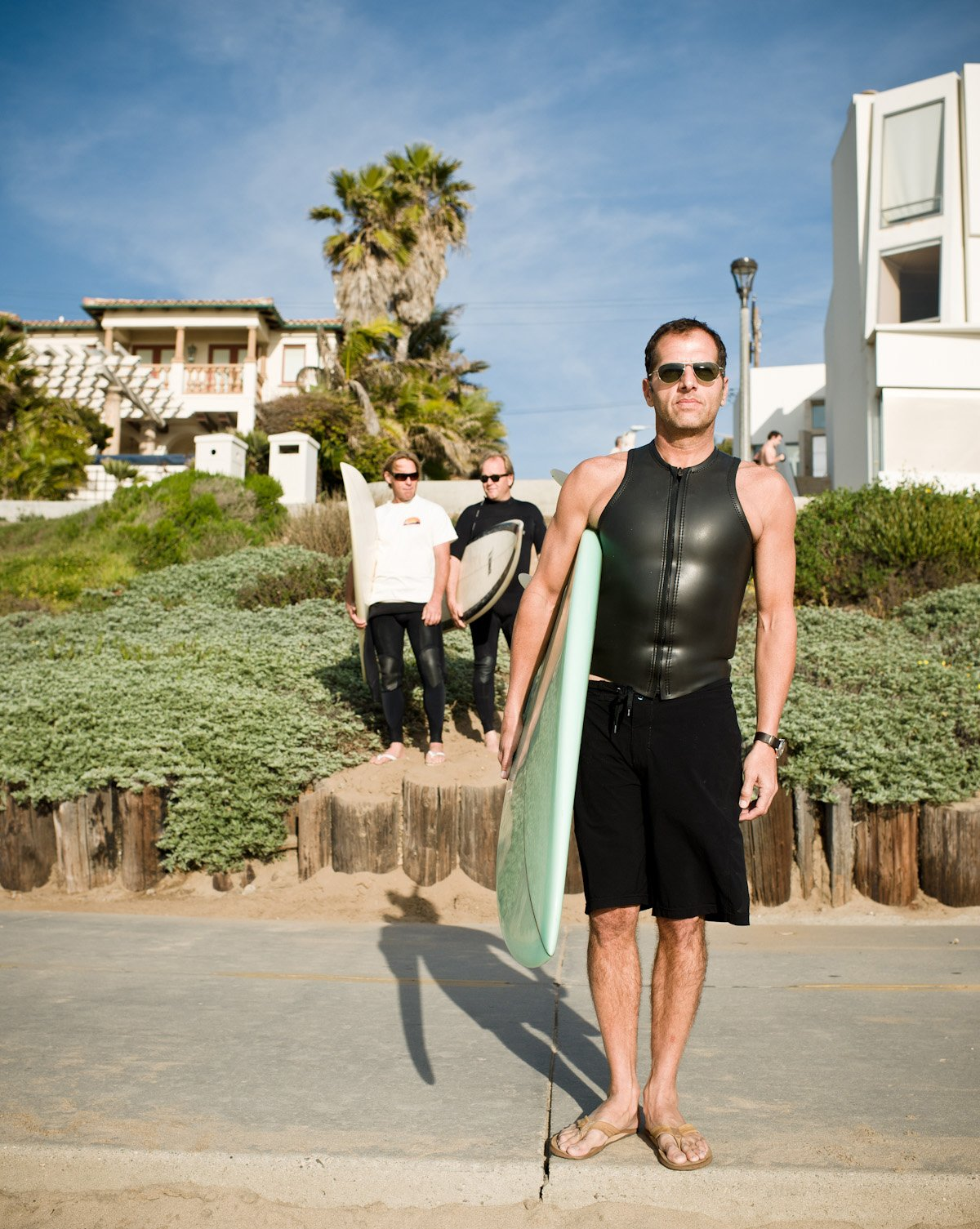Jacobson stands on the strand, trailed by Lee and McConnell. His house is just up the street behind them.  Don't miss a word of Dwell! Download our  FREE app from iTunes, friend us on Facebook, or follow us on Twitter!  Photo 18 of 18 in Less is More in this Manhattan Beach Bungalow