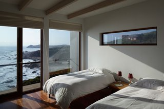 Beyond the guest bedroom lies the rocky shore and the coastline's dramatic landscape. A 20-minute walk takes Schneider and her guests to small ponds (and calmer waters) in which to swim.