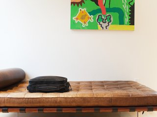 In addition to a desk that doubles as a game table, the front upstairs loft houses a weathered leather Corbusier daybed.