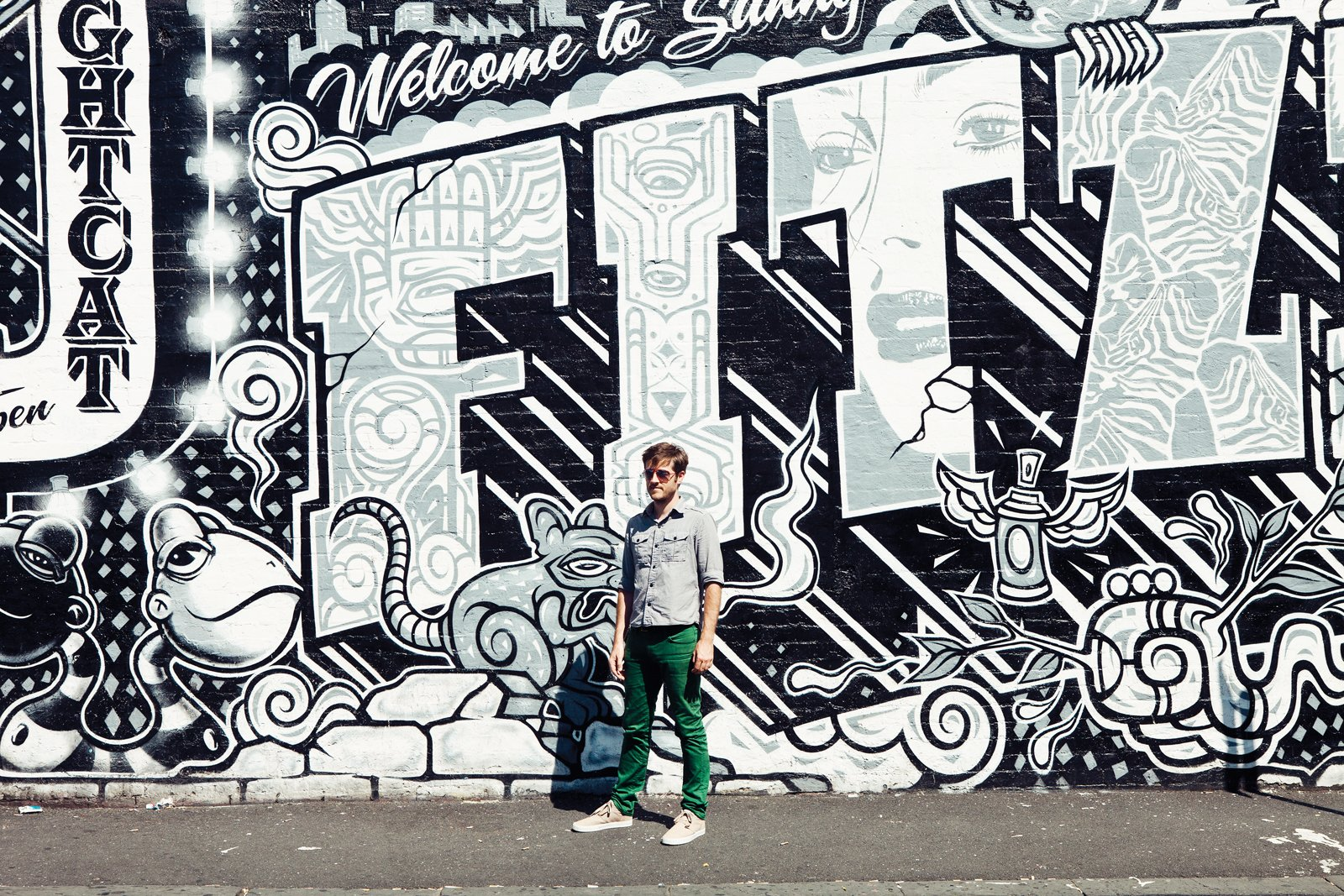 Portrait of Andrew Maynard in front of Fitzroy graffiti, off Brunswick Street, North Fitzroy  Photo 3 of 24 in Exploring Melbourne, Australia