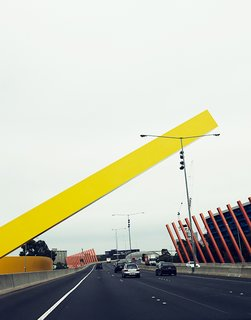 Exploring Melbourne, Australia - Photo 19 of 25 - The Citylink Freeway has all manner of massive sculpture and public art along it. This sculpture, which welcomes drivers to Melbourne, is by the architecture firm Denton Corker Marshall and went up in 1999.