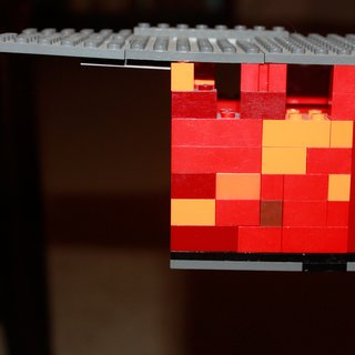 How do you represent oxidizing raw steel with Legos? A multicolored red, orange, and yellow mix helps represent the outer skin of our future home. The kids inspired me to create a rough model of our house based on our initial schematic plans. Here, a peek at the cantilevered portion of the house with the flat membrane roof.