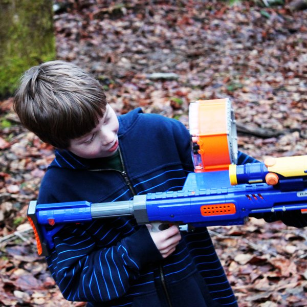 Henry takes aim with his Nerf gun while visiting the property. The forested site has provided a perfect backdrop for epic Nerf wars and other makeshift battles. The kids have gotten to know the site and become comfortable in their future backyard during frequent trips over the last couple years.