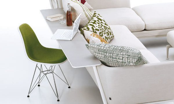 Adding a mounted shelf onto the back of the sofa creates a compact work space—or a spot for snacking. Just don't bump your soda bottle or wine glass...  Photo 3 of 7 in Suita Sofa by Antonio Citterio