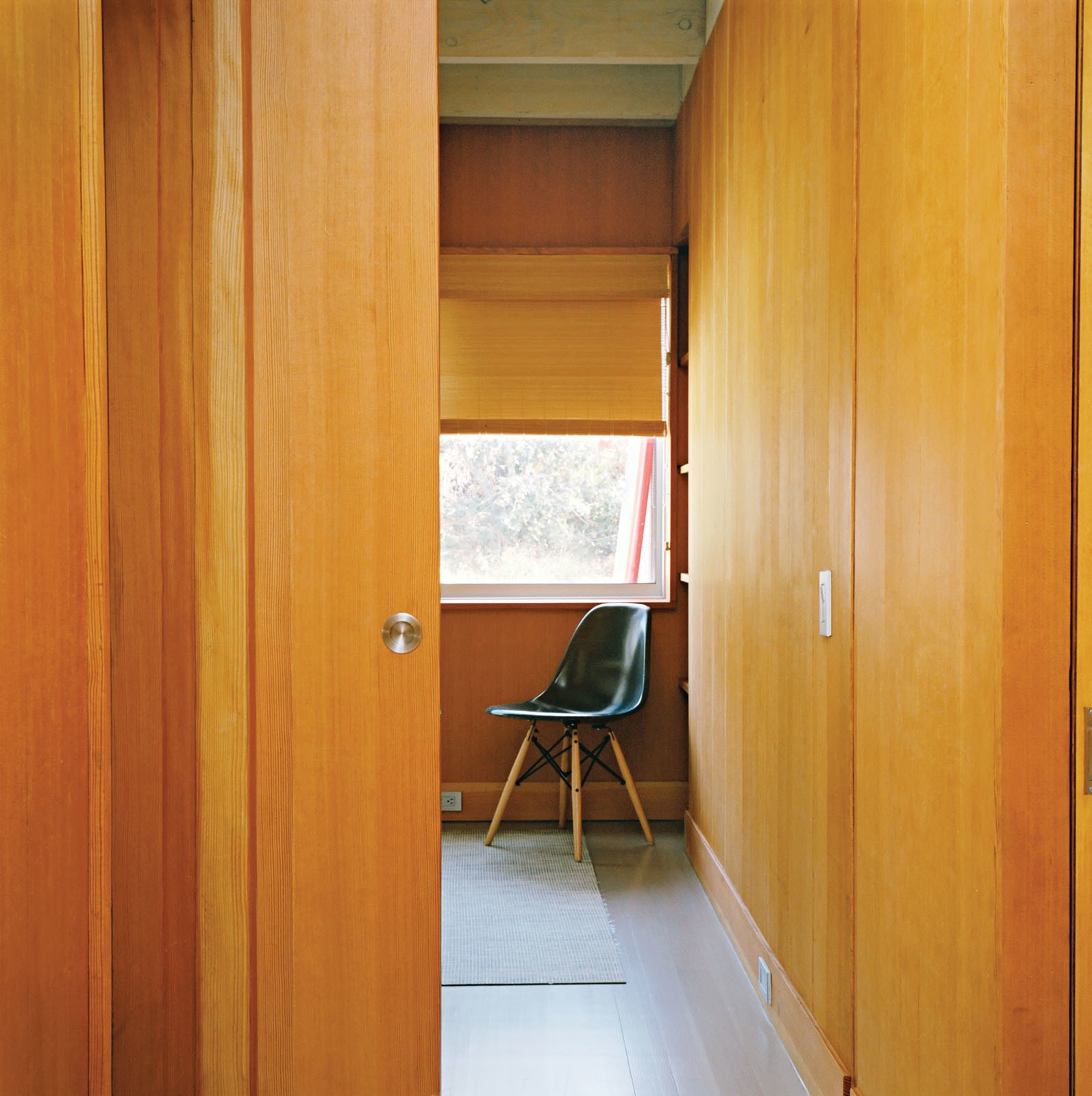Doors, Wood, Sliding Door Type, and Interior To maximize the limited square footage, there are few swinging doors in the house; instead, each bedroom has a pocket door that slides into the wall.  Photo 5 of 12 in Long Island Found