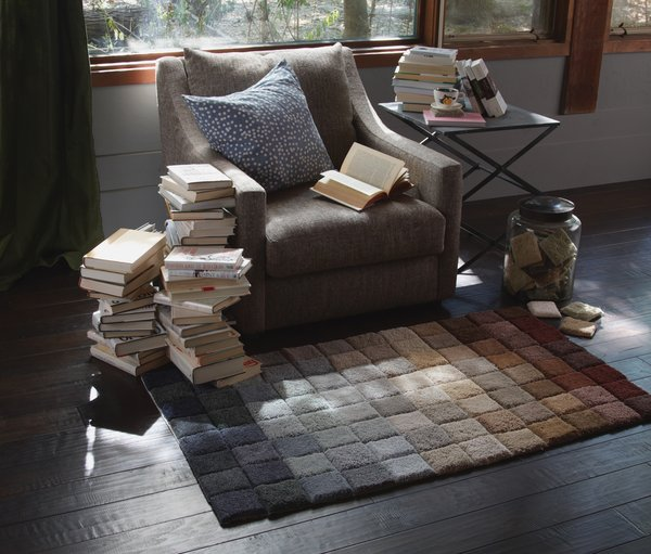 """Here's a carpet made from a gradient of about 100 sample squares. """"I think I need to preface this project with a stern warning,"""" writes Danny. """"Do not go into your local hardware of flooring store and steal all of their free samples."""""""