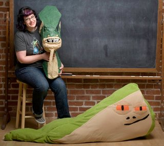 Here's Bonnie proudly posing with her Acklay head and Jabba the Hutt body pillow.