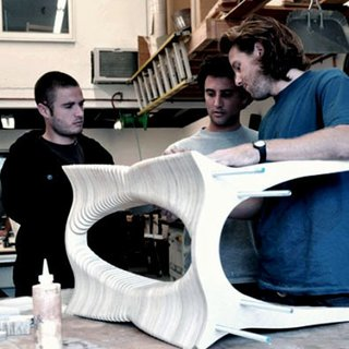 The trio inspects a table in their Laguna Beach, California, workshop.