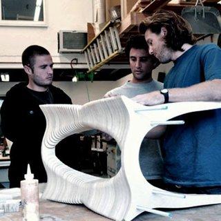 The trio inspects a table in their Laguna Beach, California, workshop.