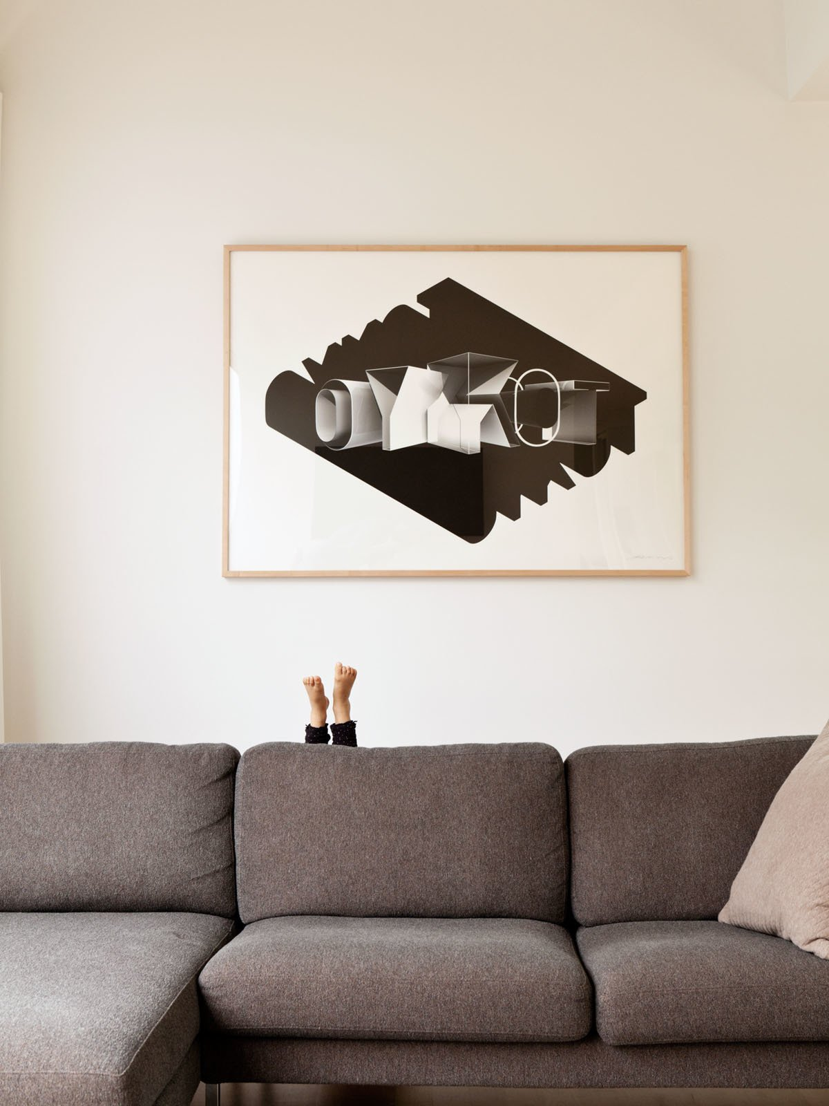 Living Room and Sofa Little feet pop up behind the Neo Sectional Chaise Left by Niels Bendtsen from DWR. The print, which reads Tokyo in reverse, was done by David's friend Eric Cruz.  Photo 9 of 13 in A Dream House for the Ages
