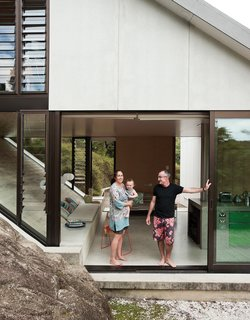 The house Amanda Yates (with her partner, Adam Rose, and their baby, Awa) designed for her parents, David and Christine, occupies a hillside site with views over Maramaratotara Bay.
