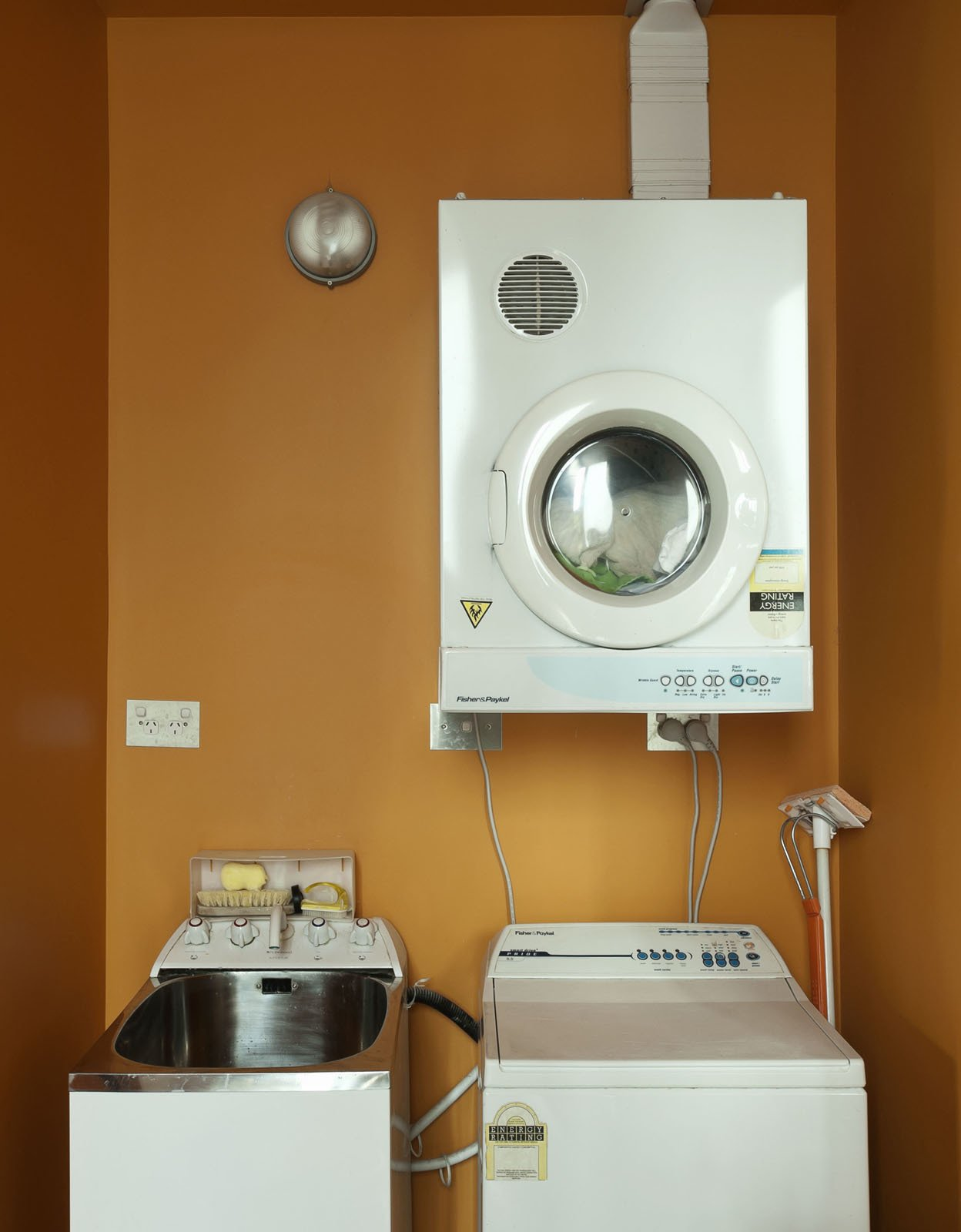 A small space for laundry.  Photo 22 of 25 in Make Your Parents Happy by Building Them a House