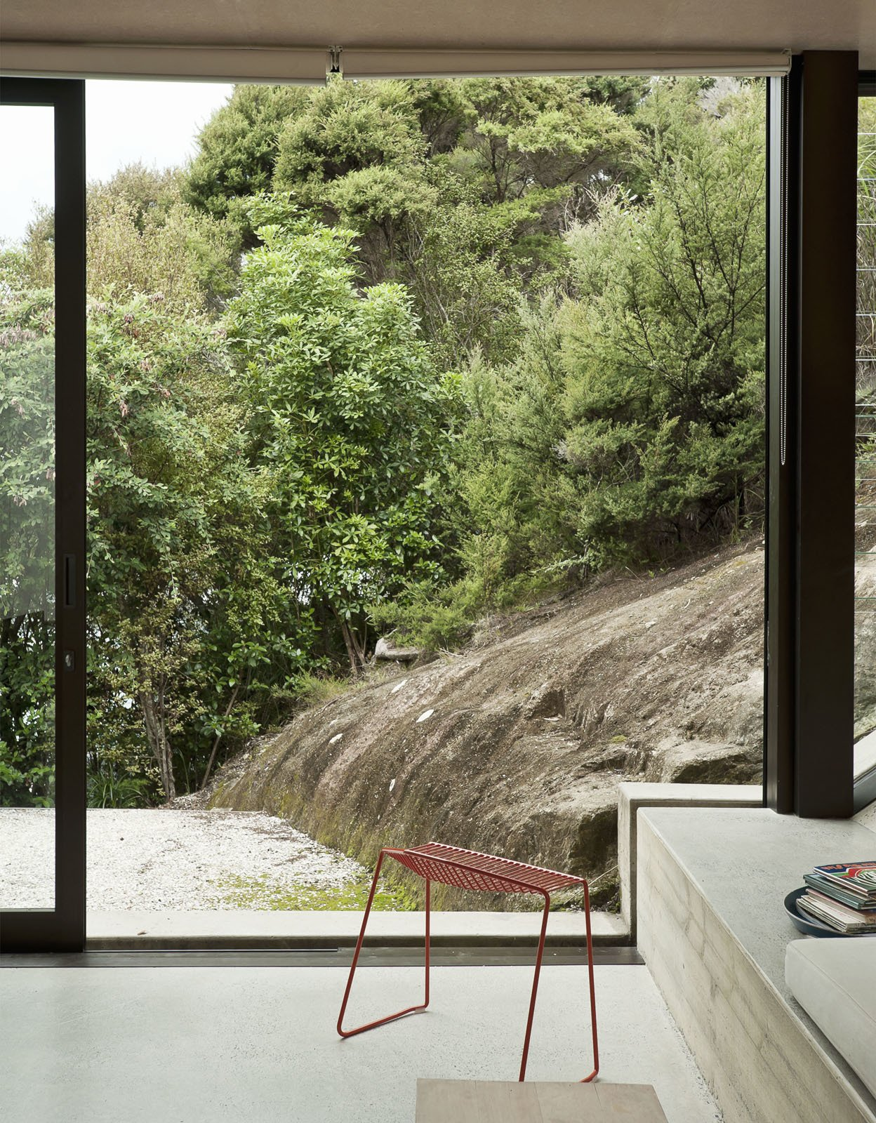 The rock slope just outside is in clear sympathy with the concrete cant inside—nature right alongside architecture.  Photo 23 of 25 in Make Your Parents Happy by Building Them a House