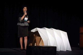 From the Show Floor: Pecha Kucha - Photo 3 of 7 - Tina Hovsepian explains her Cardborigami prototype.
