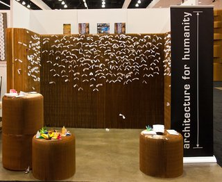 This photo, by Barry Schwartz, is of Architecture for Humanity's booth at Dwell on Design. The wall is by Molo and the tiny white slips of paper are wishes affixed thereto.