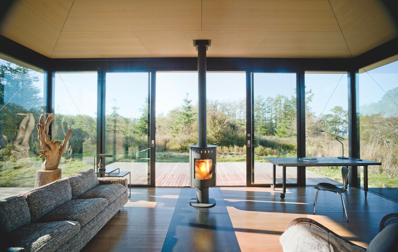 Living Room, Wood Burning Fireplace, and Sofa Architects: Kirsten Murray, Tom Kundig  Photo 2 of 3 in A Minimal Writer's Retreat in the Pacific Northwest