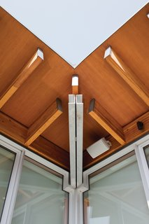 The visible structural engineering is part of the beauty of the home's design. At the roof corner, a double-channel steel hip beam and cantilevered wood rafters come together like pieces of a puzzle.