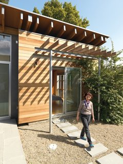 The master bedroom has sliding doors that connect directly to the backyard.