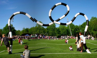"""Puckelball"" is a variant of soccer played on a field that looks like it was attacked by giant moles with a goal designed by the Mad Hatter. Its creator, artist Johan Strom, thinks of it as a metaphor for life: <br><br>""Many live under the belief that life is a fair playing field, that both pitch halves are just as big and the goal always has at least one cross. But ultimately the ball never bounces exactly where you want it to and the pitch is both bumpy and uneven."" The world's only Puckelball pitch is in Malmö, Sweden, a city with many other great playgrounds and public spaces as well. Definitely worth a trip!"