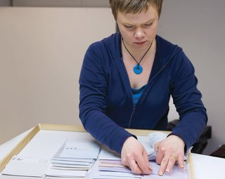 In the color-selection room, Taina Tiilikainen thumbs through swatches to help designers pick the perfect combinations