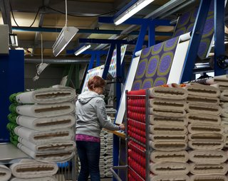 Next, Marimekko's quality inspectors, some who have worked at the company for more than 30 years, hand-inspect and grade the fabric. Theirs is a meticulous task: There can be only four small errors over 16 yards of fabric.