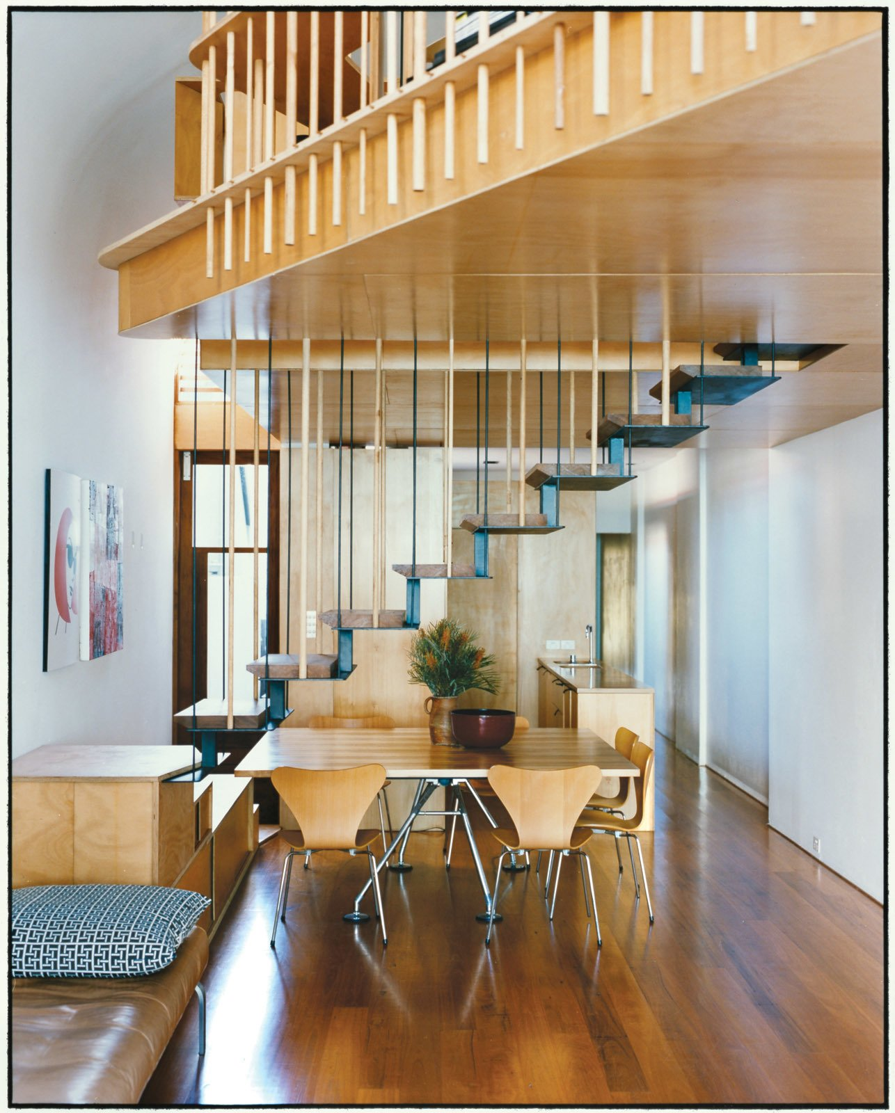 The addition's most eye-catching feature is the steel staircase with recycled blackbutt wood treads. The bottom steps double as benches to supplement the six Arne Jacobsen Series 7 dining chairs for Fritz Hansen and a Nomos table base by Sir Norman Foster for Tecno.  Photo 3 of 8 in Almost Perfect