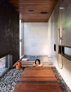 At the opposite end of the house, the soaking tub gets almost daily use. The bath and shower fixtures are by Dornbracht