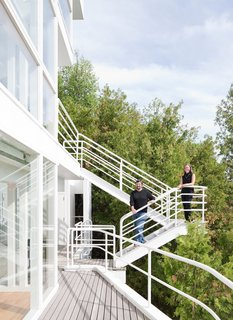 This Lake House Is a Living Piece of Architecture History - Photo 10 of 21 - Michael McCarthy and Marcia Myers on the exterior promenade.