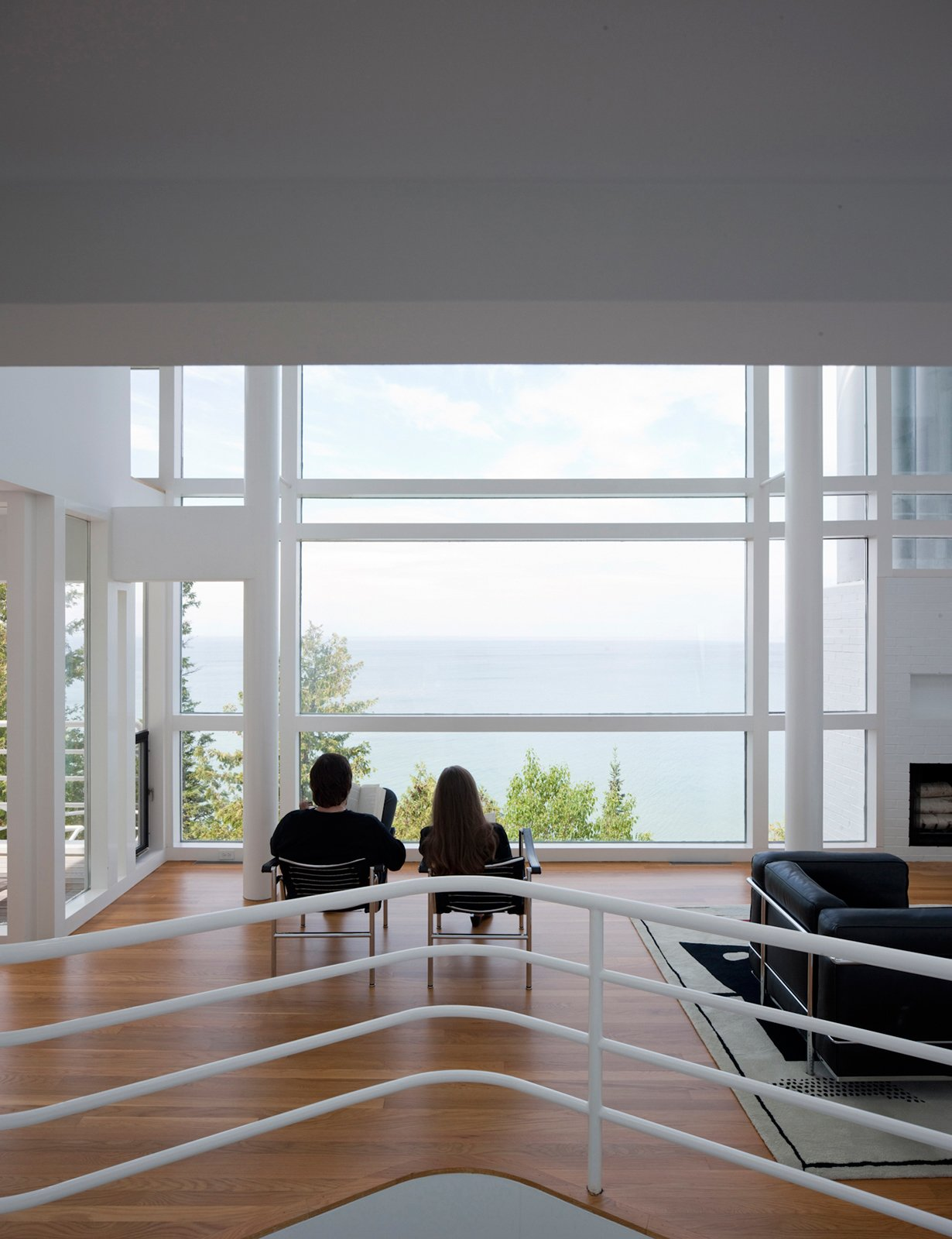 The pair take in the expanse of Lake Michigan. The Douglas House's views are completely unencumbered.  Photo 21 of 22 in This Lake House Is a Living Piece of Architecture History