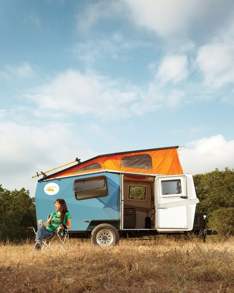"In early May, I headed down to Texas to report the October 2011 issue Off the Grid story about a sustainable home in Austin and then drove an hour out of the city to spend a night camping in a Cricket Trailer, a small, self-contained pop-up camper. Cricket Trailer founder and designer Garrett Finney drove from Houston, where he manufactures the trailers in a 5,000-square-foot factory, and met me at the 9E Ranch in Smithville. After orienting me to what he calls ""a portable adventure living space,"" he took off and I spent the evening camping out and testing all the Cricket Trailer has to offer."