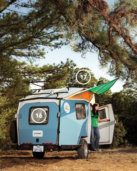 "Although Finney believes that when you're camping ""you're supposed to leave your house and its comforts at home,"" the Cricket's canopy (17) lends the trailer a homey feel while providing a triangle of shade. The back pops open to provide easy access to the under-bench storage and to bring in a breeze (16)."