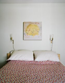 The master bedroom. The coverlet is from Urban Outfitters. The painting is by Helen Rice.