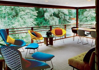 Hometown Hero - Photo 4 of 28 - A screened-in porch overlooks the pond and sports furniture by both Harry Bertoia and Dow himself.<br><br>Photo by: Balthazar Korab