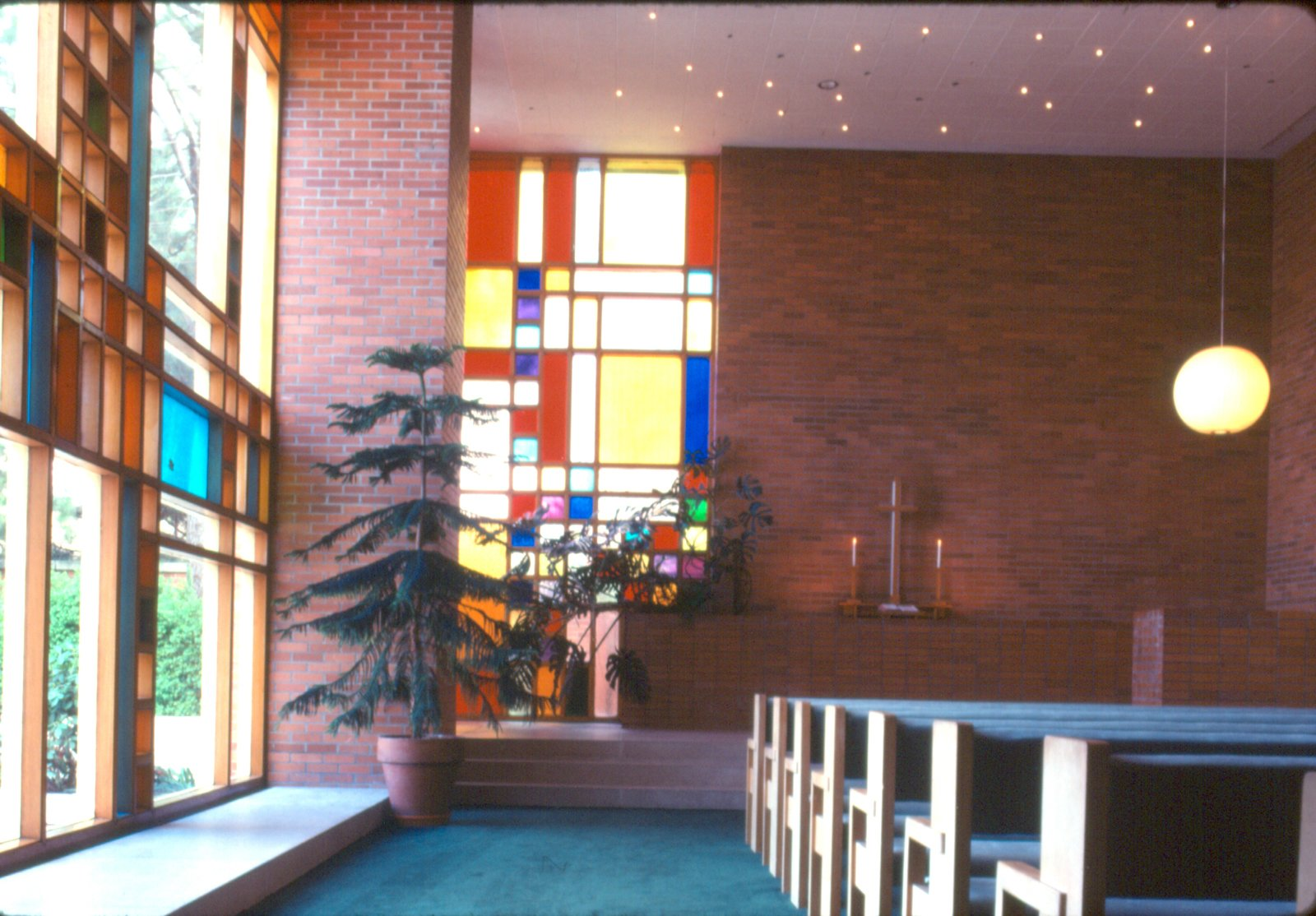 Blocks of color in the stained glass windows and decidedly more sober brick are the dominant materials of the main sanctuary of Midland's First Methodist Church.  Photo 22 of 28 in Hometown Hero