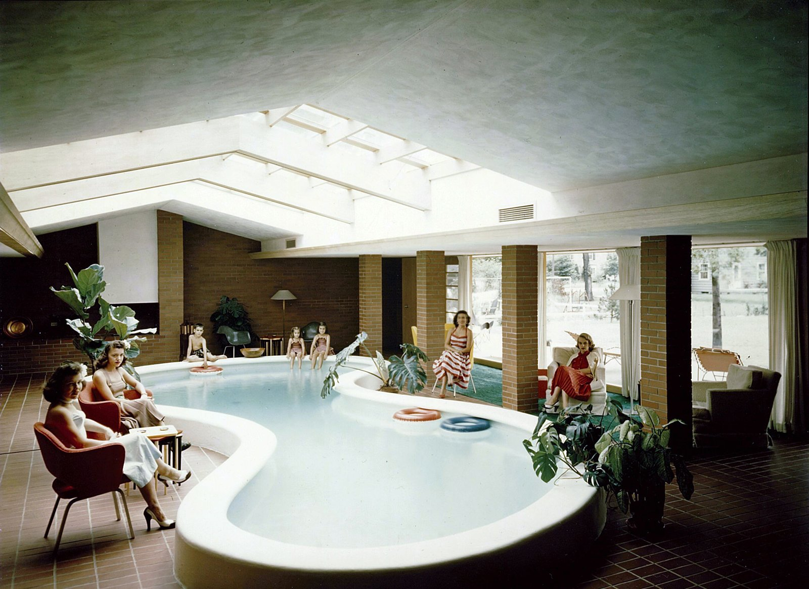 If there's a groovier picture of mid-century modernism I don't know it. This is the living room/indoor pool of the Defoe House Dow designed in Bay City, Michigan in 1941.  Photo 24 of 28 in Hometown Hero