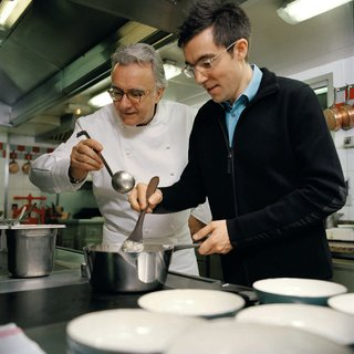 Ducasse (left) and Jouin (right) cook together using the Pasta Pot that they collaborated together to create.