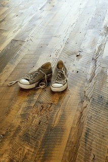 The wood floor of the Suttles and Shah residence reclaimed from a barn in Missouri.