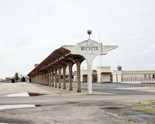 Downtown Wichita offers a compelling mix of old—such as a weathered concrete sign by the train tracks at the disused Union Station on Douglas Avenue.